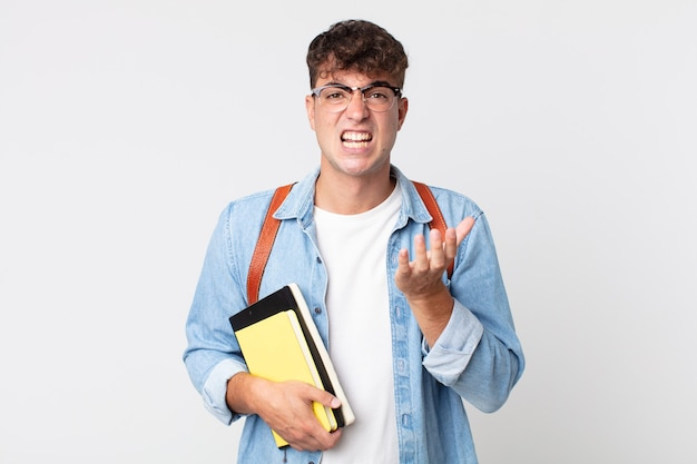 Giovane bell'uomo che sembra disperato, frustrato e stressato. concetto di studente universitario