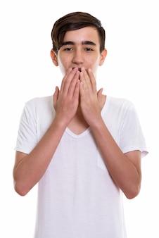 Giovane adolescente persiano bello che sembra scioccato