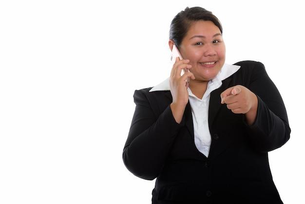 Giovane felice grasso asiatico imprenditrice sorridendo