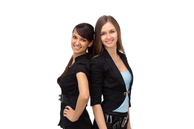 Donne d'affari giovani e sexy isolate su bianco