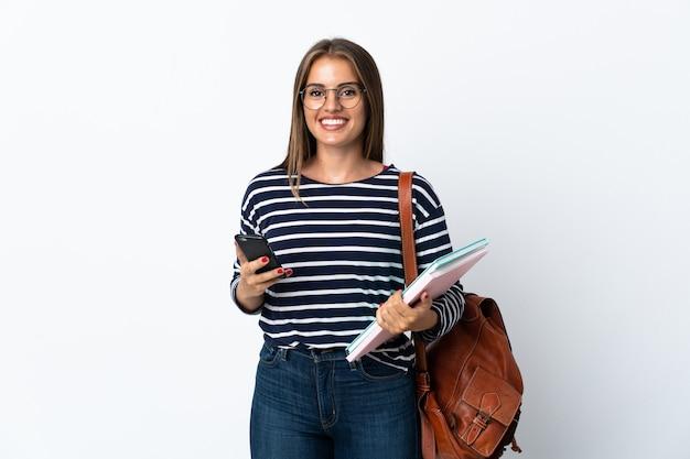 Giovane studente donna isolato azienda caffè da portare via e un cellulare