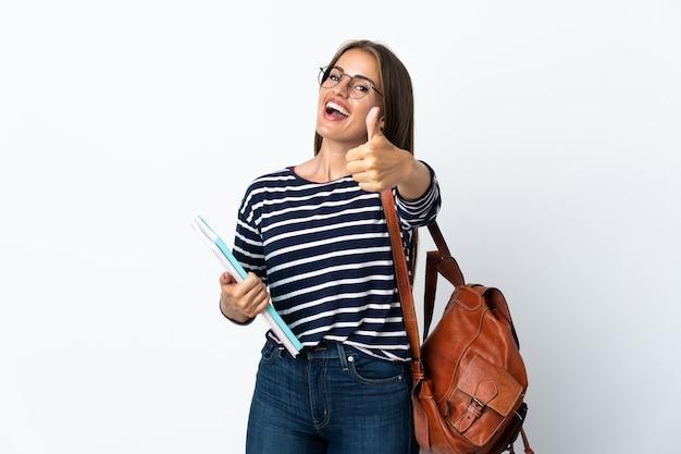 Donna giovane studentessa isolata con i pollici in su perché è successo qualcosa di buono