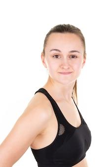 Il ritratto della giovane donna mette in mostra la ragazza su bianco Foto Premium