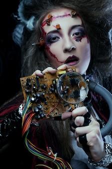 Giovane donna con trucco creativo. tema di halloween. tema zombie.
