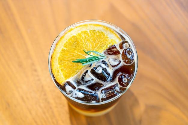Yuzu orange coffee glass in coffee shop cafe restaurant