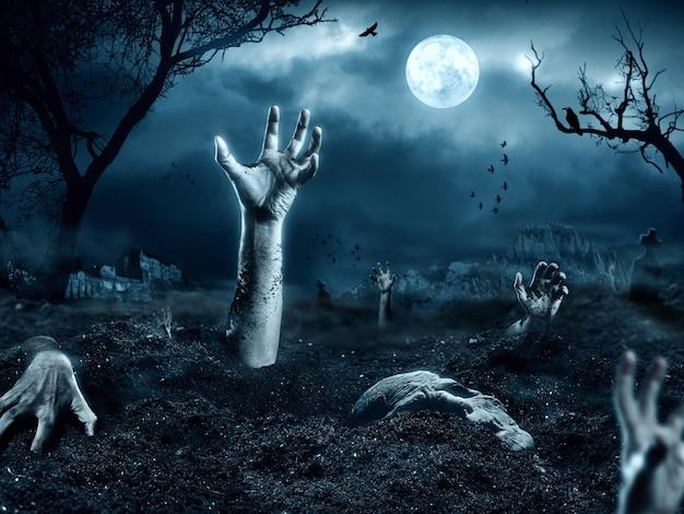 Mano di zombie che esce dalla sua tomba