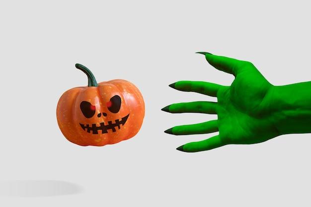 La mano verde dello zombi con una zucca di halloween