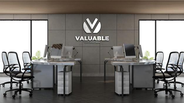 Modello 3d del logo aziendale nell'area di lavoro dell'ufficio con interni di design industriale