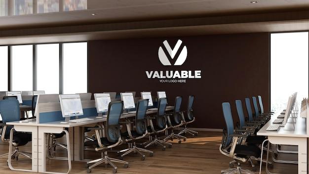 Modello 3d del logo aziendale nell'area di lavoro dell'ufficio Psd Premium