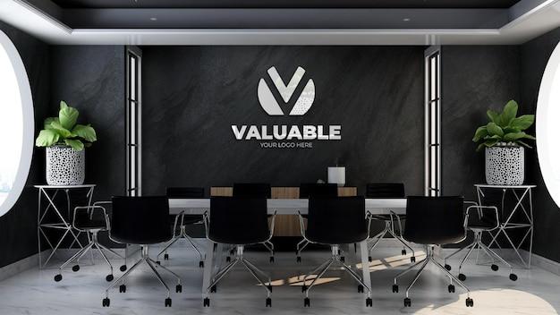 Modello 3d del logo aziendale nella sala riunioni dell'ufficio con muro di pietra nera