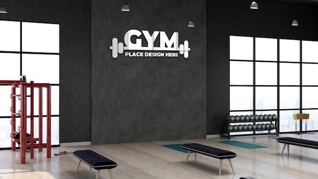 Modello 3d del logo della palestra nella sala fitness per l'allenamento dell'atleta con muro di pietra nera