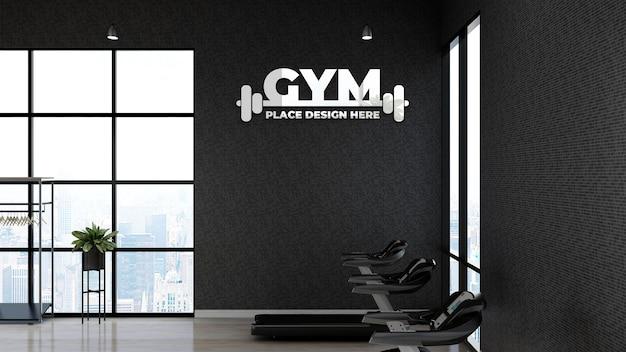 Modello 3d del logo della palestra nell'area fitness con la parete nera per l'atleta