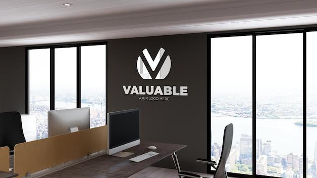 Mockup di logo 3d nel posto di lavoro dell'ufficio muro nero