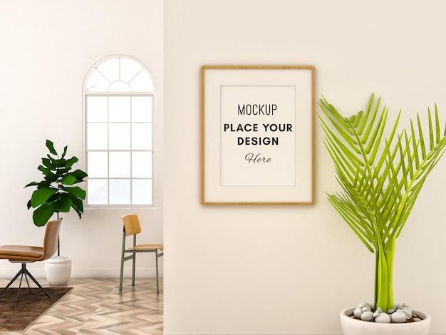 Cornice mockup 3d su parete bianca con stanza minimalista