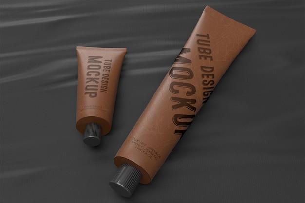 Mockup di packaging design 3d di due tubi in pelle vintage bugiardo