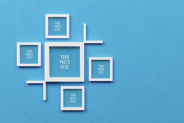 Mockup di cornice per foto 3d sulla parete blu chiaro vuota