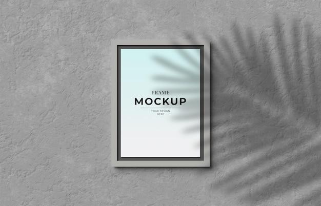 Mockup di foto 3d render frame con ombra sul muro
