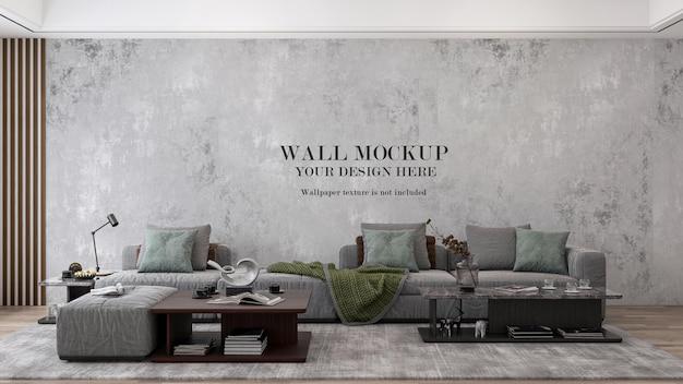 3d render mockup muro dietro un grande divano in tessuto grigio