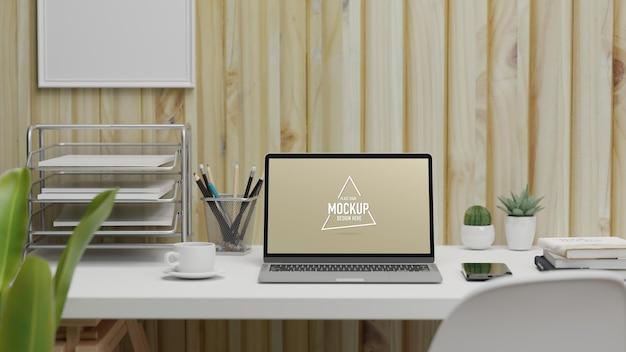 Area di lavoro di rendering 3d con laptop