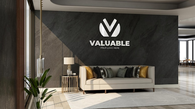 Modello d'argento del logo dell'azienda 3d nella sala d'attesa dell'ingresso dell'ufficio con divano