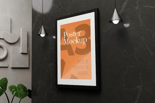 Mockup di poster a3 sul muro di marmo nero