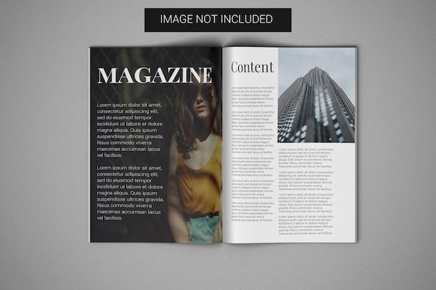 Modello di rivista a4 aperto nella vista superiore della pagina centrale