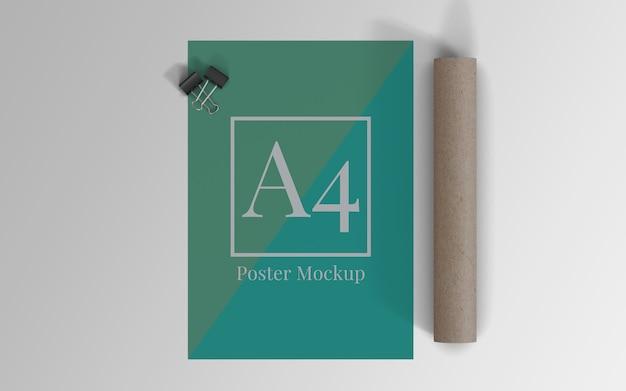 Mockup di poster a4 con clip binder e rotolo di cartone vista dall'alto