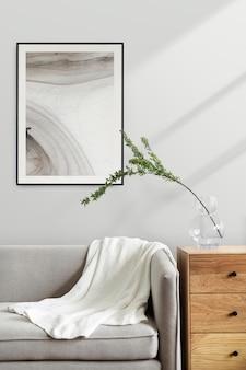 Mockup di cornice estetica psd in un soggiorno con arredamento scandinavo