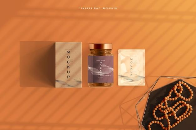 Vaso cosmetico in vetro ambrato con bustina e scatola mockup