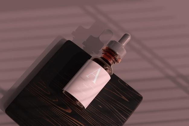 Mockup di flacone contagocce in vetro ambrato