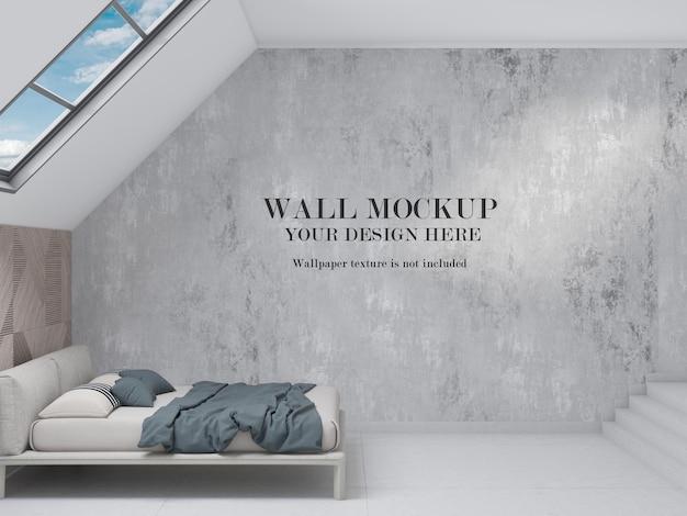 Mansarda camera da letto vista laterale mockup parete