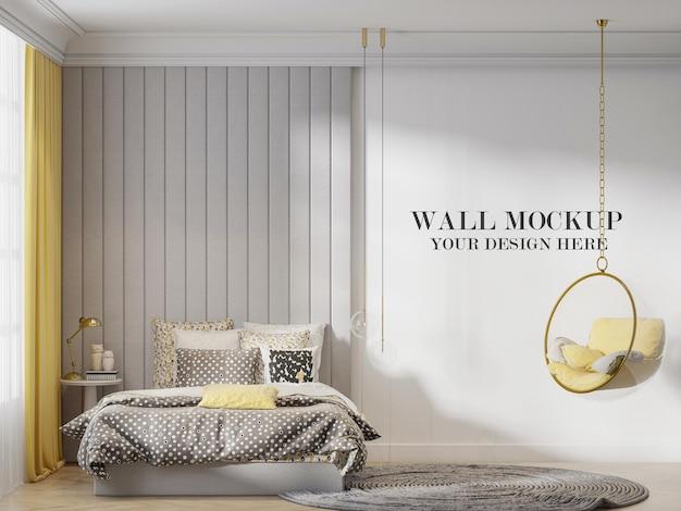 Mockup della parete della camera da letto dietro la sedia a dondolo