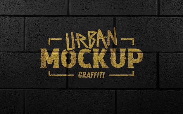 Mockup logo spray dorato muro di mattoni neri