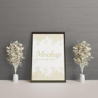 Mockup cornice nera tra pianta decorazione coppia
