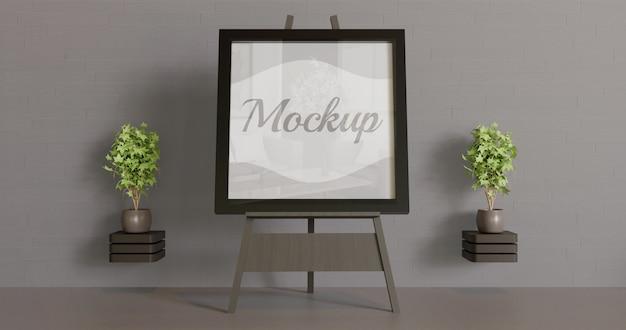 Mockup di cornice nera sul cavalletto. mockup per opere d'arte, logo. foto, ecc