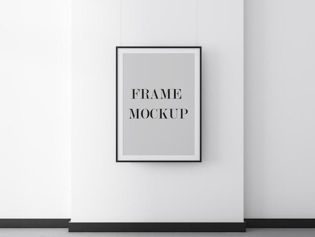 Mockup di fotogramma poster nero sul muro bianco
