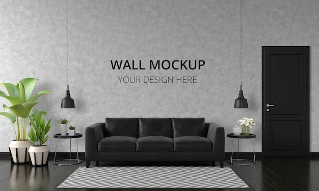 Divano nero nell'interno del soggiorno con mockup a parete