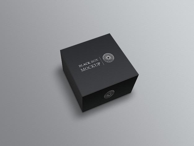 Scatola quadrata nera mockup su grigio