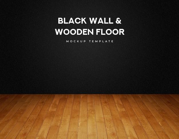 Parete nera e pavimento in legno con pannelli in parquet