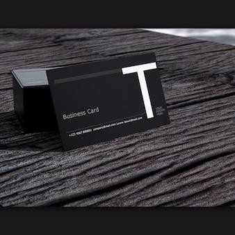 Biglietto da visita in bianco sul vecchio fuoco selettivo di legno scuro