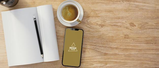 Taccuino in bianco con lo spazio della copia del caffè del modello dello schermo in bianco dello smartphone sulla tavola di legno
