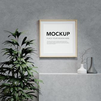 Mockup di cornice per foto in bianco sullo scaffale di cemento