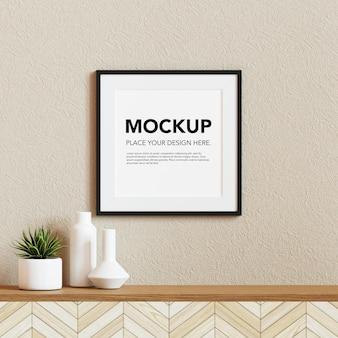 Mockup di cornice per foto in bianco sul muro