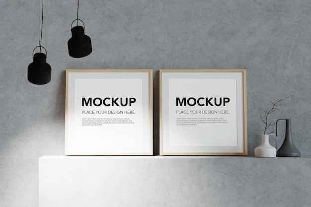 Mockup di cornici per foto in bianco sullo scaffale di cemento
