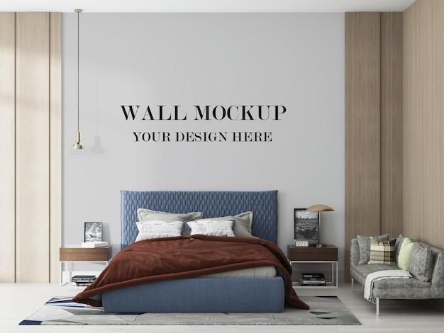 Muro bianco dietro il letto blu nella rappresentazione 3d