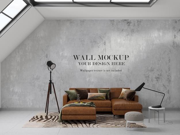 Mockup di muro bianco dietro il moderno divano blu