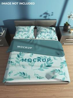 Mockup di coperte e cuscini