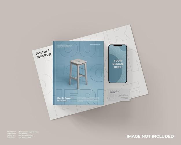 Mockup di copertina del libro, smartphone e biglietti da visita sul mockup del poster