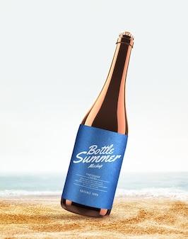 Pubblicità di bottiglie sulla spiaggia mockup Psd Premium