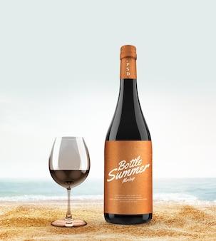 Mockup di bottiglia e bicchiere sulla spiaggia